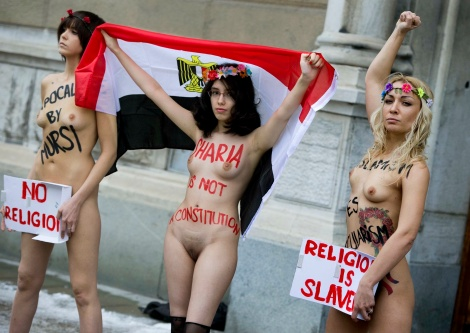 Members of Femen Protesting the Egyptian Constitution at the Egyptian Embassy in Stockholm