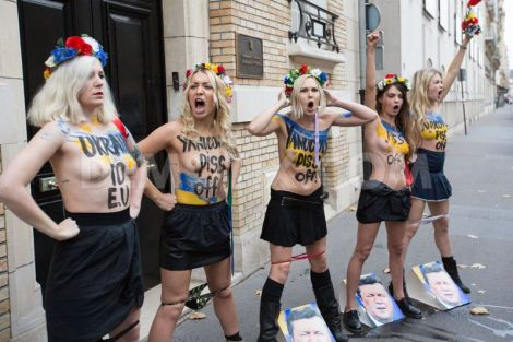 Femen Protestors urinate  on picture of YanuKovych