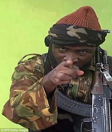 1DC5698200000578-2910580-Master_of_disguise_Boko_Haram_leader_Abubakar_Shekau_points_at_t-m-9_1421325439083